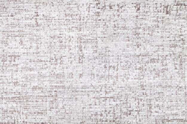 柔らかい、フリースの布の白いふわふわの背景。繊維のクローズアップのテクスチャ