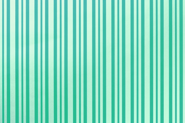 Зеленый и бирюзовый фон от оберточной полосатой бумаги.