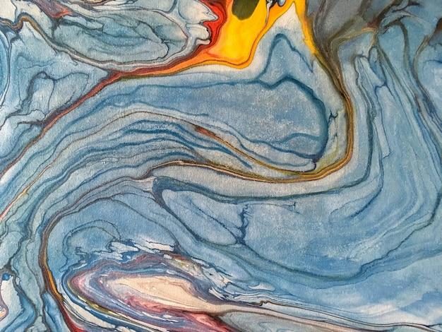 塗料の青い水しぶきの背景。アートワークの断片