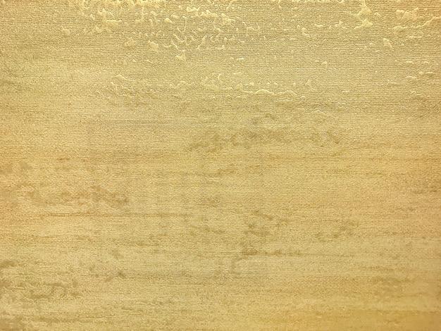 Текстура золотые обои с рисунком. желтая бумажная поверхность, крупный план структуры.