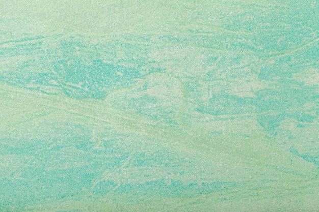 抽象芸術の背景ライトグリーン色。キャンバス上の多色塗装。