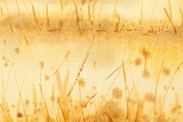 Абстрактное искусство фон светло-желтого и коричневого цветов. акварельная живопись на холсте с золотым градиентом.