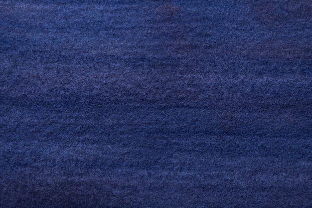 抽象芸術の背景のネイビーブルーの色。柔らかい紺碧のグラデーションでキャンバスに水彩画。インディゴパターンのアートワークの紙の断片。テクスチャ背景。