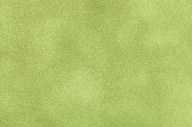 薄緑色のマットスエード生地のクローズアップ。ベルベットの質感。