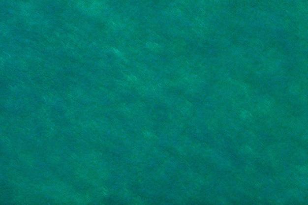 フェルト生地の緑の背景。ウール織物のテクスチャ