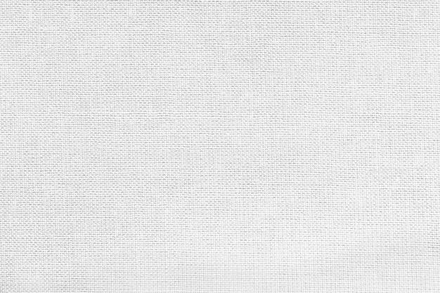 繊維材料からの白い背景。自然な風合いの生地。背景。