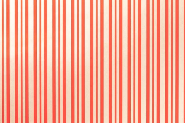 縞模様の紙を包むことから光の赤と金色の背景。