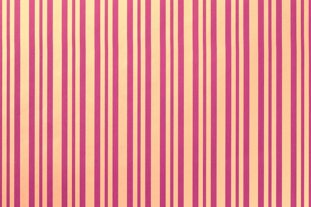 縞模様の紙の折り返しからの薄紫と金色の背景