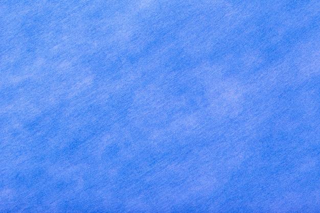 フェルト生地の濃い青の背景