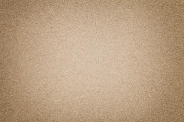 Текстура старой светло-коричневой бумаги фона