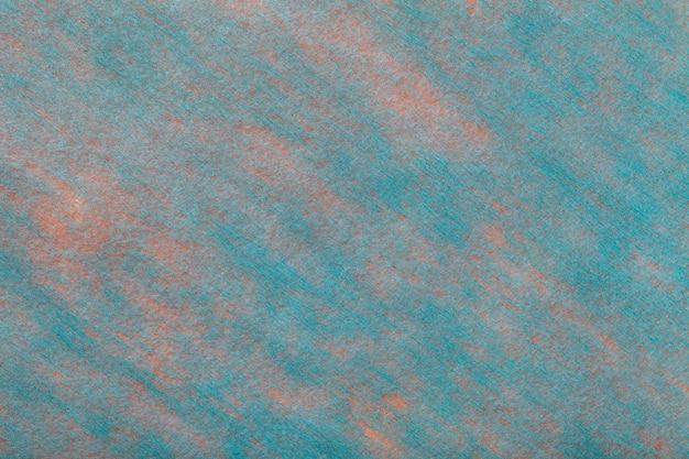 フェルト生地の水色とピンクの背景