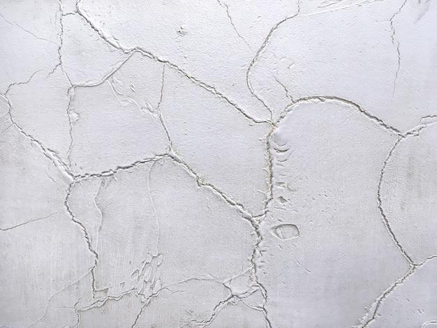 古い剥離壁を模倣してテクスチャ背景装飾的な灰色石膏。