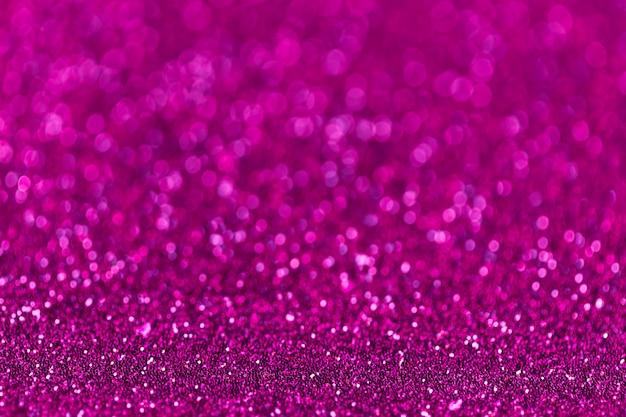 小さなスパンコール、クローズアップから紫色の輝く背景