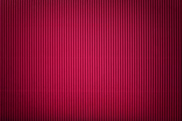 Текстура гофрированной красной бумаги с виньеткой
