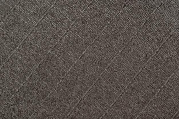 波状段ボール紙の暗い茶色の背景のテクスチャ