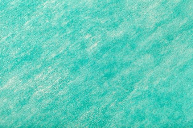 フェルト生地の明るいターコイズブルーの背景