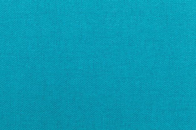 繊維材料からの明るい青の背景。
