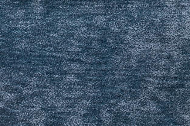 柔らかく、フリースの布の青いふわふわの背景。繊維のクローズアップのテクスチャ