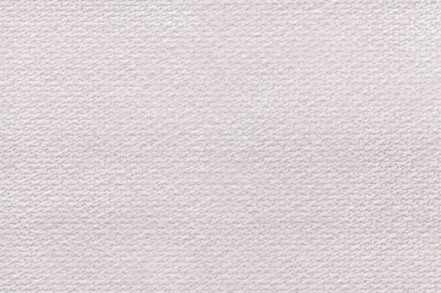 柔らかく、フリースの布の白いふわふわの背景。繊維のクローズアップのテクスチャ