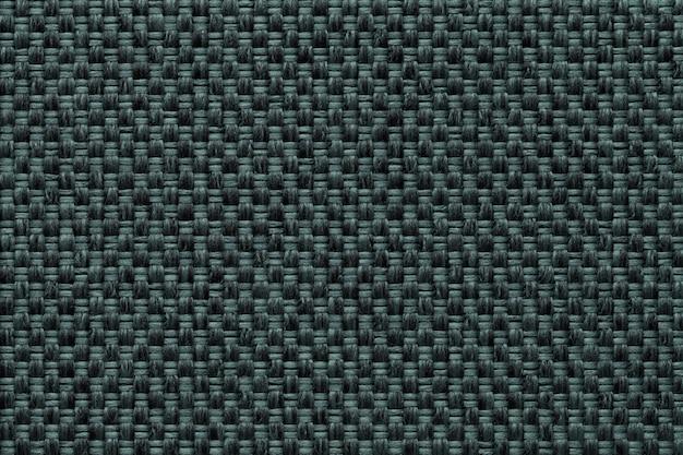 市松模様、クローズアップで暗い緑の繊維の背景。ファブリックマクロの構造。