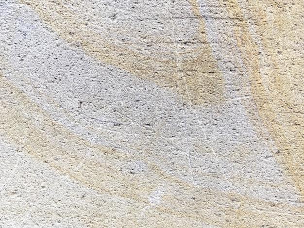 ベージュの古代石、背景のテクスチャ