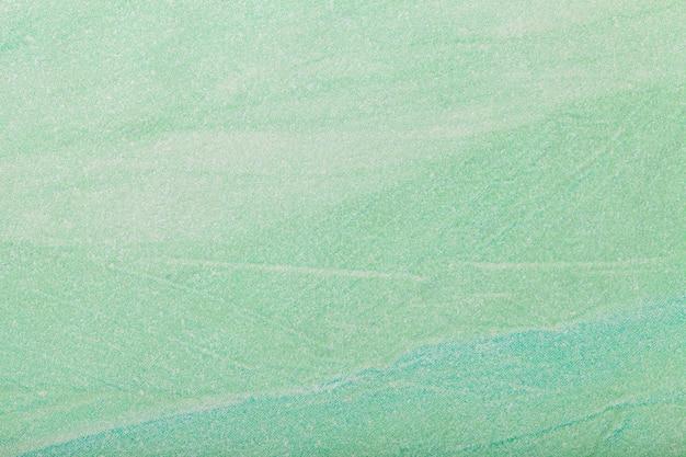 抽象芸術の背景の薄緑色。キャンバスに多色塗装。