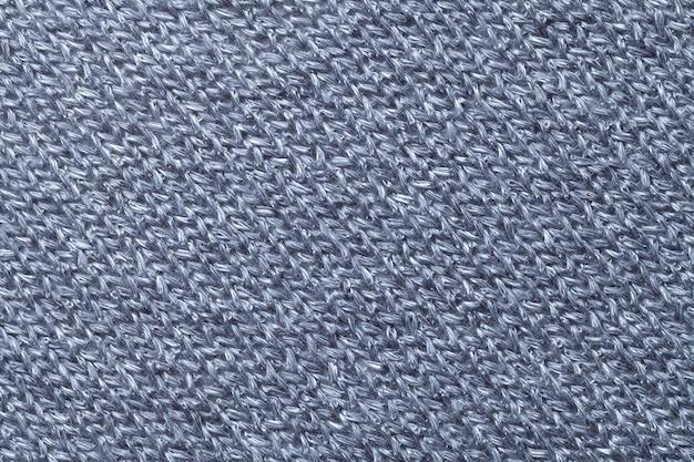 青い繊維の背景のクローズアップ。ファブリックマクロの構造
