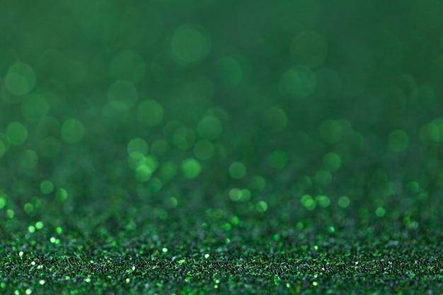 小さなスパンコール、クローズアップから緑の輝く背景。華麗な背景