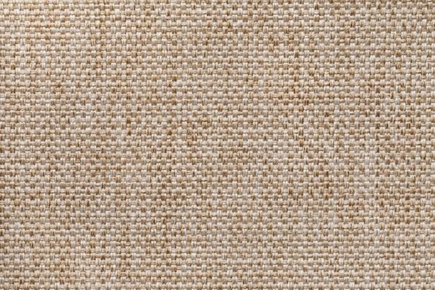 薄茶繊維の背景のクローズアップ。布マクロの構造