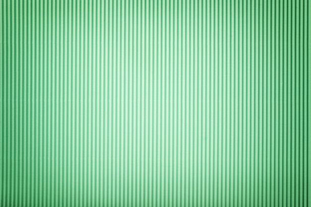ビネットと段ボールの緑紙のテクスチャ、マクロ。