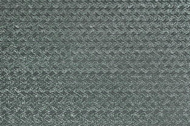 波状の光沢のある模様のギフト包装紙。緑の背景