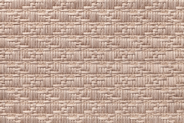 柔らかく毛羽立った布の模様の茶色のニットウール。繊維のクローズアップのテクスチャ。