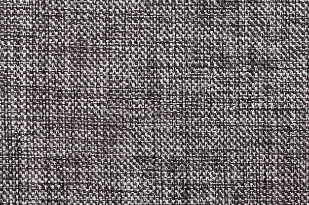黒と白の繊維のクローズアップ。ファブリックマクロの構造