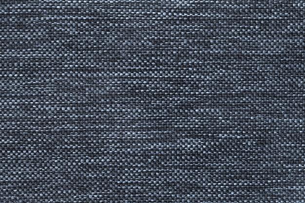 濃い織りのバギング生地のダークブルー、クローズアップ。テキスタイルマクロの構造。