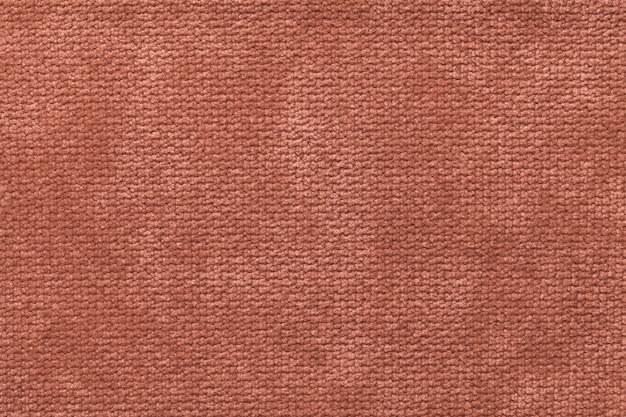 ふわふわの柔らかい布のふわふわした薄茶色。光おむつ織物、クローズアップのテクスチャ。