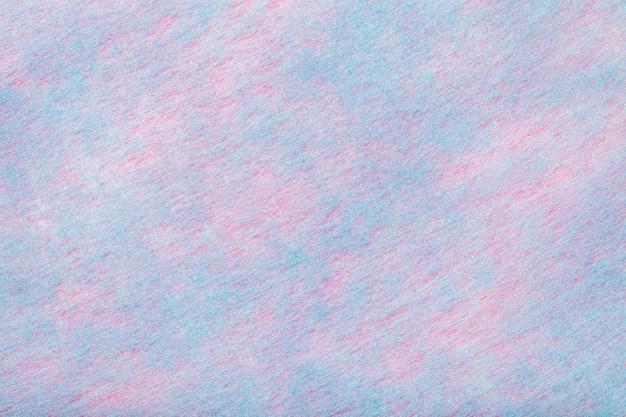 フェルト生地の明るいピンク。ウール織物のテクスチャ