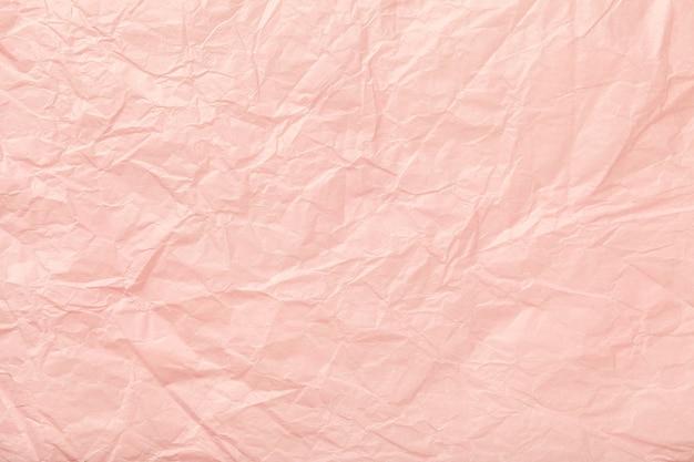 しわくちゃのピンクの包装紙のテクスチャ
