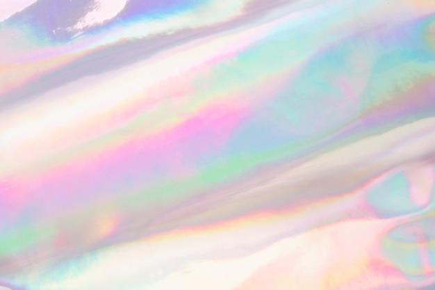 ホログラフィック虹色のしわのある生地。複数の色で抽象的なテクスチャ。