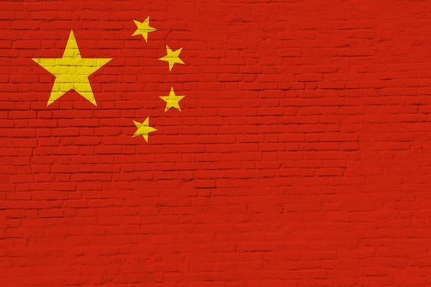 レンガの壁に描かれた中国の国旗