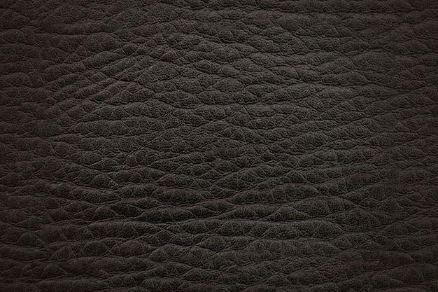ダークブラックブラウンレザー。テクスチャ表面。