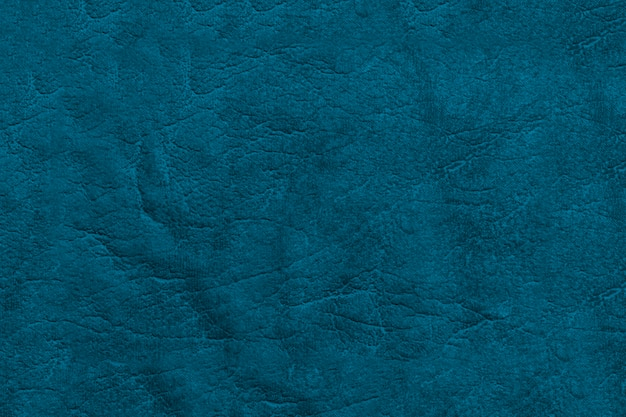 Красивый синий фон из натуральной кожи. текстурная поверхность с рисунком.