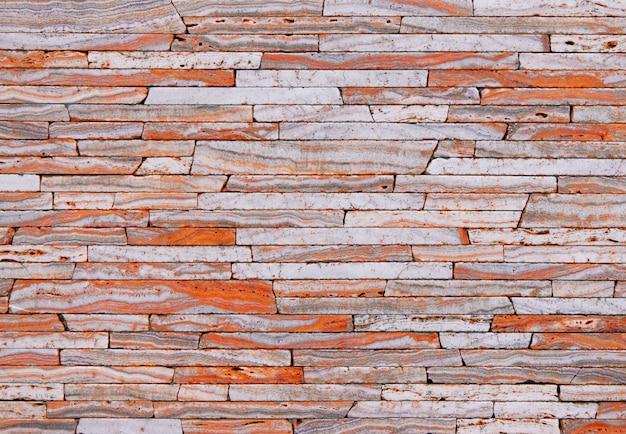 クリームオレンジ色のブロックから石のテクスチャ