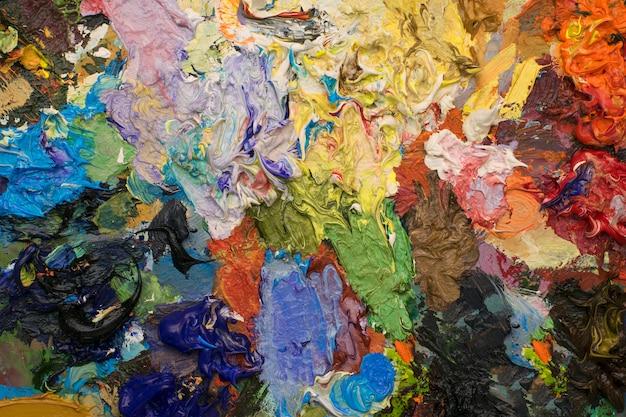 異なる色のオイルペイント。カラフルな現代美術、オイルペイントの背景