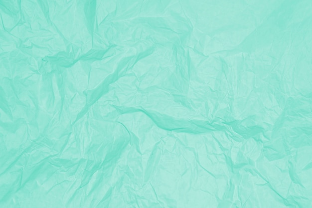 Зеленый мятый лист бумаги, фон, текстура