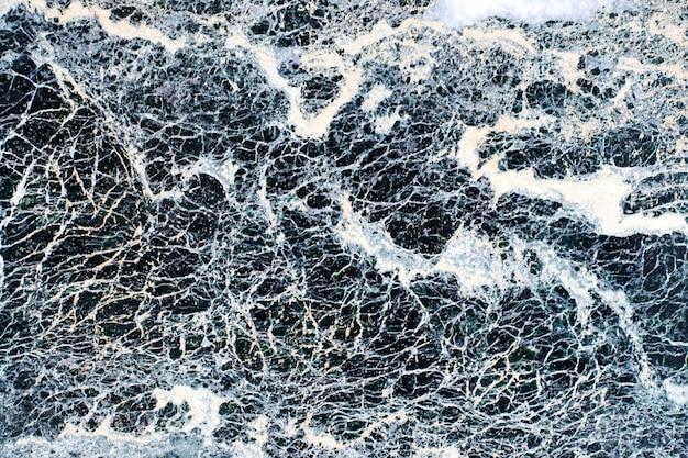 灰色の大理石模様の石のテクスチャ。