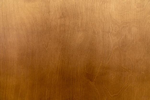 木製の背景、黄色の汚い合板テクスチャ