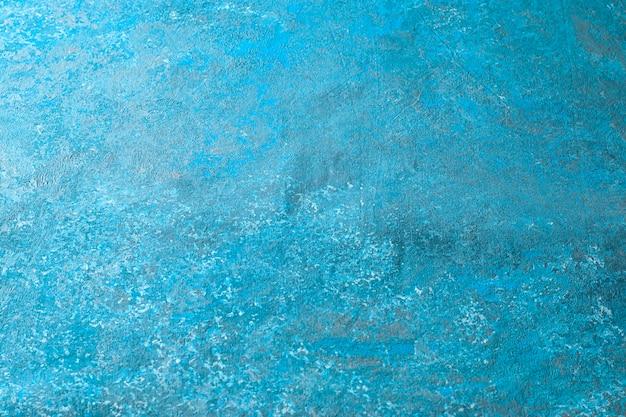 薄い布(テクスチャ)に青と白の色合いの抽象的なパターン。