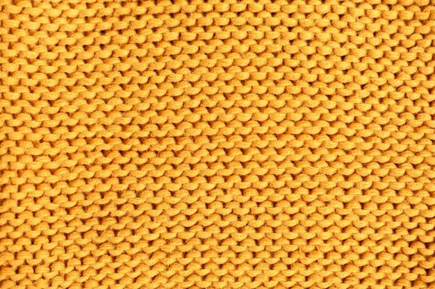 黄色のニットのテクスチャ。