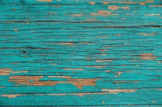 古いターコイズブルーの木製の背景