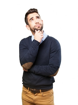 Задумчивый мальчик, одетый в свитер